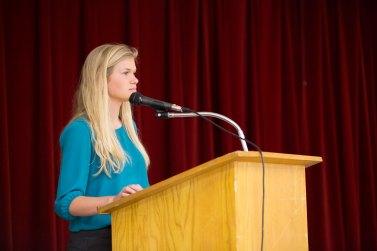 Faux Wesleyan Spokeswoman Heather Birge delivers press release.